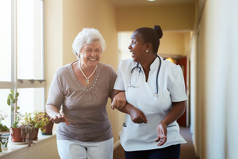 Assisted Living Nurse Helping Resident at Peaceful Pines Senior Living Community Rapid City, SD